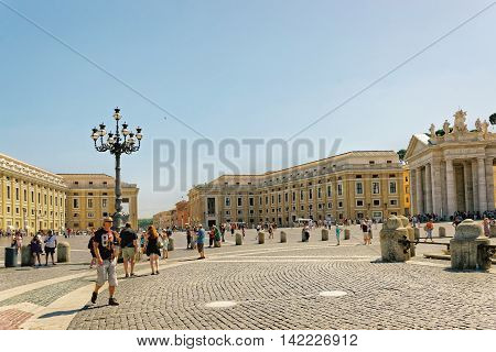 Tourists And Saint Peters Square In Vatican In Italy