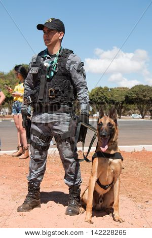 Brasilia, Brazil-August 4, 2016: Brazilian Police Officer with his K-9  Patrolling Outside the Mané Garrincha Stadium for the 2016 Rio Olympic Games