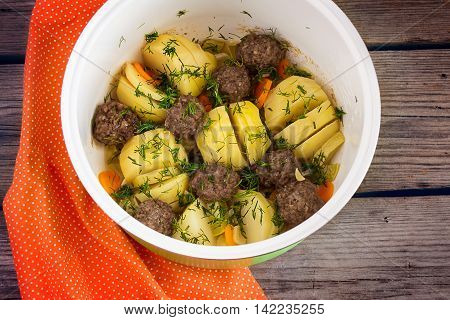 stewed potatoes with meatballs in the crock-pot.
