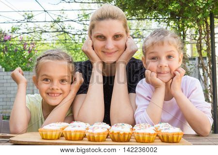 Mother And Two Daughters Have Prepared Easter Cupcakes