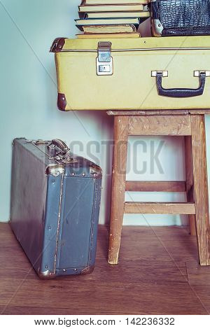 Vintage Composition with old books suitcases and stool. Pastel colors