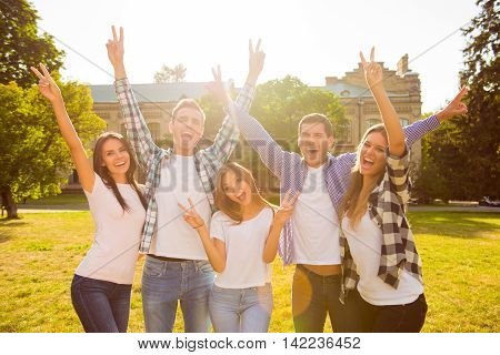 Five Cheerful Best Friends Having Fun  And Rise Hands  With Gesture V-sign