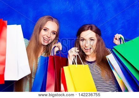Portrait Of Two Happy Pretty Shoppers After Shopping Mall