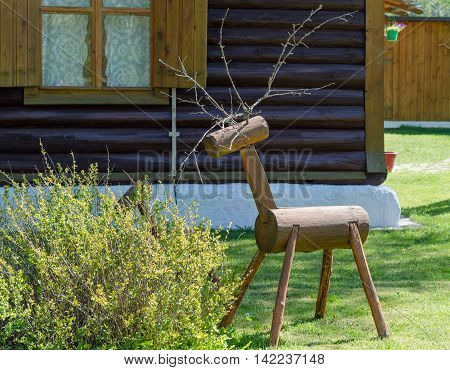 Decorative figure of a deer of a tree trunk