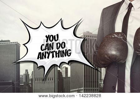 You can do anything text on speech bubble with businessman wearing boxing gloves
