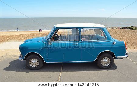 FELIXSTOWE, SUFFOLK, ENGLAND - MAY 01, 2016: Classic Blue Riley Mini Motor car parked on seafront promenade.