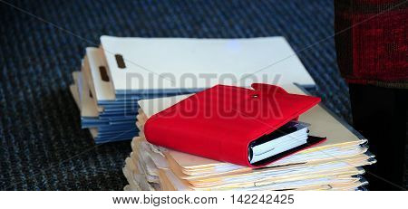 Case study files on the floor inside a business office.