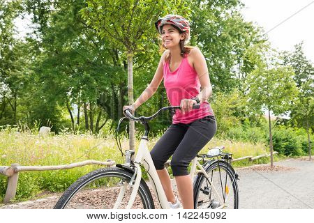 Smiling Young Happy Woman Enjoying Ride On Bicycle