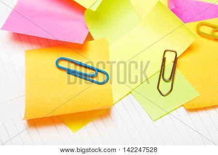 School background with colorful sticky notes and paper clips