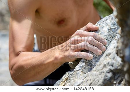 Man's hands holding grip. Muzzerone mountain, Liguria, Italy