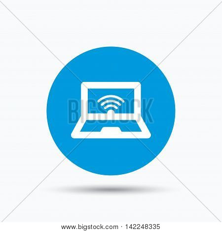 Computer with wifi icon. Notebook or laptop pc symbol. Blue circle button with flat web icon. Vector