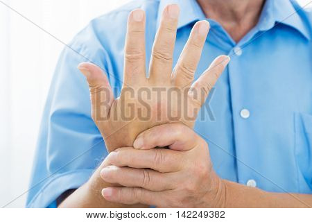 Close-up Of A Person's Hand With Pain On The Wrist