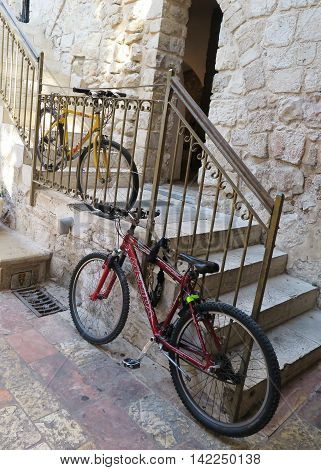 Jerusalem Israel - July 15 2015: Bicycles protected against theft in the old part of Jerusalem. No seat in one of the bike there was a string to secure.
