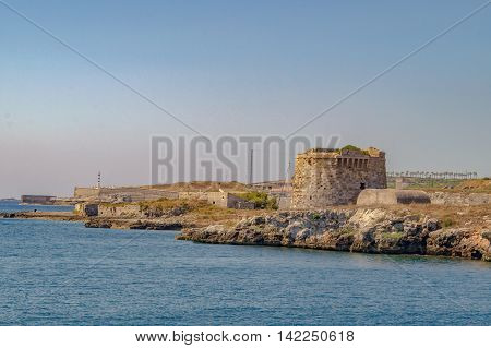 Mahon/Spain. 21st June 2012. The port of Mahon in Menorca on a warm summer's day. An old fort guards the harbor entrance.