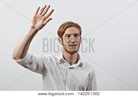 Young Adult Male in White Shirt Gesturing, Waving His Hand