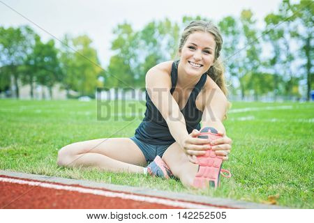 A Runner woman jogging on a field outdoor shot