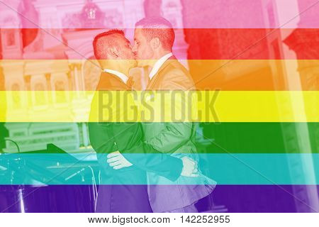 A Portrait of a loving gay male couple on their wedding day inside the church.