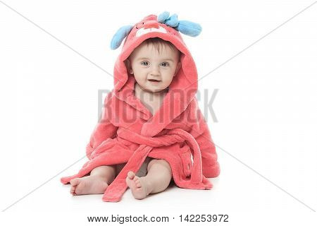 A little cute girl in a bathrobe isolated on a white background