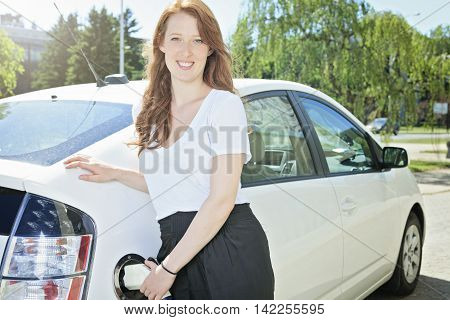 A woman who Put Energy on Hybrid Vehicle