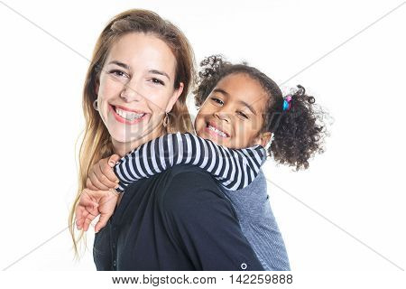 A family posing on a white background studio piggyback