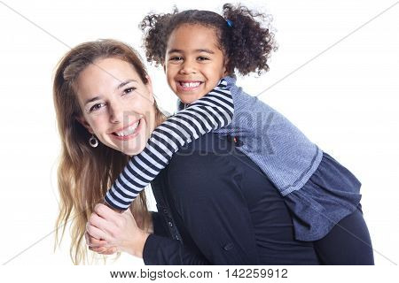 A portrait of happy cheerful African family children on piggyback
