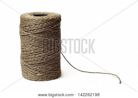 Reel of thread isolated on white background. The thread is phytogenic.