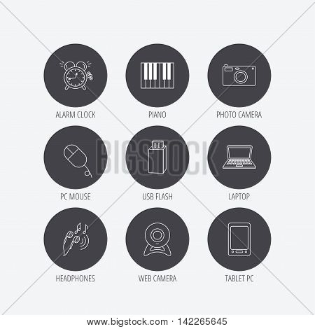 Photo camera, USB flash and notebook laptop icons. PC mouse, alarm clock and web camera linear signs. Tablet PC and music headphones icons. Linear icons in circle buttons. Flat web symbols. Vector