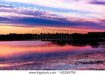 A beautiful, colorful, vivid sunrise on lake Wausau in Wisconsin.
