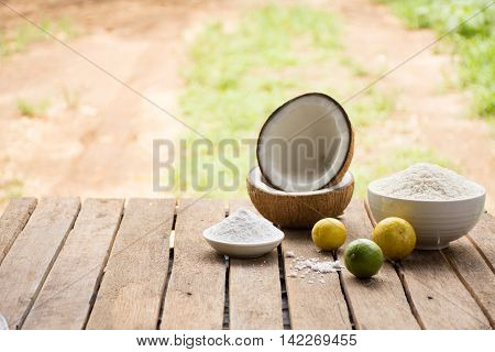 Raw material for food and dessert.Lemon and coconut powder and Sticky rice on old wooden background outdoor.Raw material Asia food.Raw material Indian food