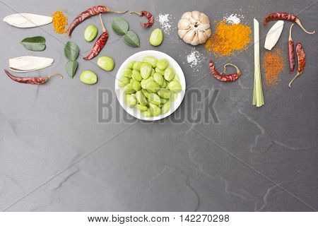 Parkia speciosa dish and ingredient  for thai food hot and spicy menu with black background.