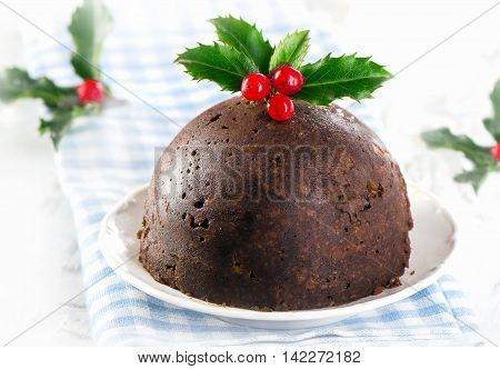 Christmas Pudding With Holly On A White Plate.