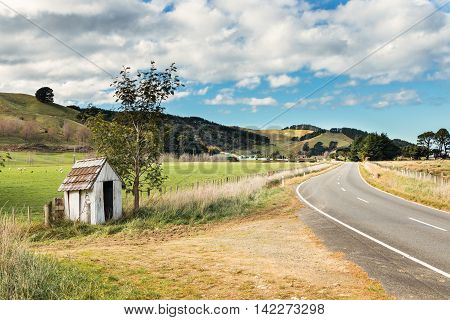 Bus stop shelter on a New Zealand country road.
