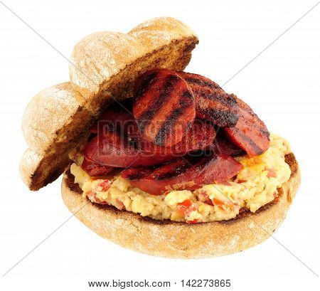 Spicy chorizo and chickpea sandwich roll isolated on a white background