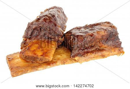 Two slow cooked beef short ribs isolated on a white background