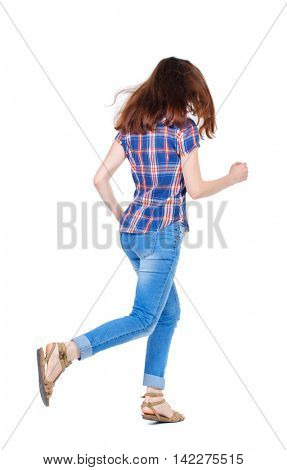 back view of running  woman. beautiful girl in motion. backside view of person.  Rear view people collection. Isolated over white background. Girl in plaid shirt with fluttering hair runs off into the