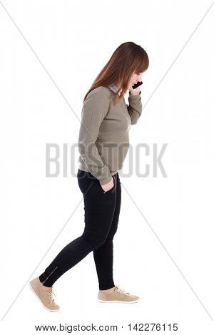 side view of a woman walking with a mobile phone. back view of girl in motion.  backside view of person.  Rear view people collection. Isolated over white background. with his hand in the pocket of a