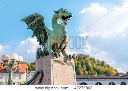 Dragon statue on the bridge in Ljubljana city in Slovenia. This statue is the main symbol of slovenians capital.