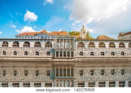 View on Ljubljanica river with building and church in Ljubljana city in Slovenia