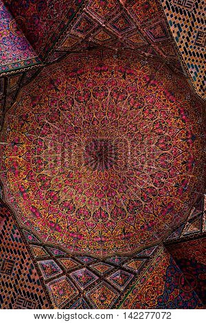 SHIRAZ IRAN - 3 MAY 2016: Detail of the ceiling tilework decoration in the Nasir al Molk or Pink Mosque in Shiraz Iran.