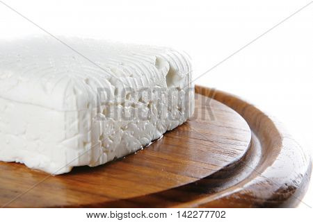 light white cheese on dishware over white