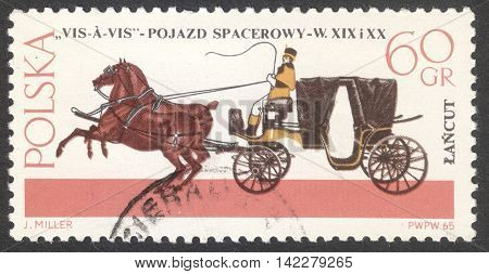MOSCOW RUSSIA - CIRCA MAY 2016: a post stamp printed in POLAND shows a Vis-a-vis coach the series
