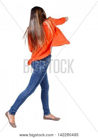 back view of woman funny fights waving his arms and legs. Rear view people collection. backside view of person.  Isolated over white background. girl in a red jacket hand strikes.