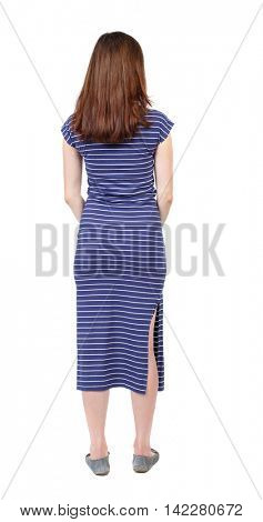 back view of standing young beautiful  woman.  girl  watching. Rear view people collection.  backside view of person.  The brunette in a blue striped dress standing back