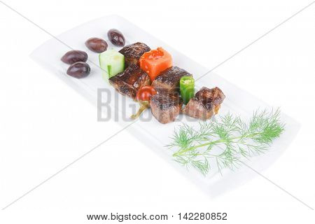 east european food: roast beef meat goulash over white plate isolated on white background with vegetables