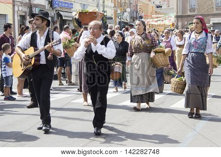 QUARTU S.E., ITALY - September 15, 2013: Wine Festival in honor of the celebration of St. Helena - Sardinia - group of people in Sardinian costumes parading through the streets of the city