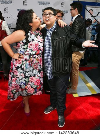 NEW YORK-APR 11: Actors Raini Rodriguez (L) and Rico Rodriguez attend the world premiere of