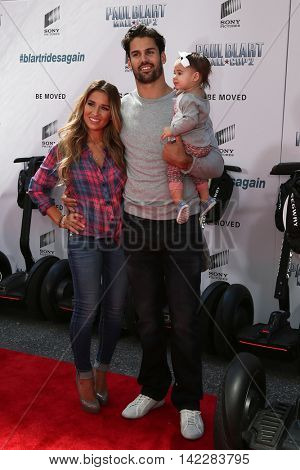 NEW YORK-APR 11: (L-R) Jessie James Decker, NFL player Eric Decker and daughter Vivianne attend the premiere of