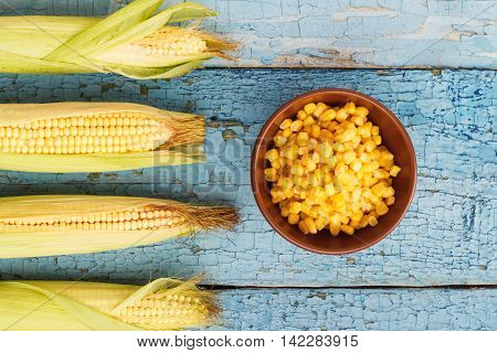 The Line Of Raw Corn And Bowl With Corn