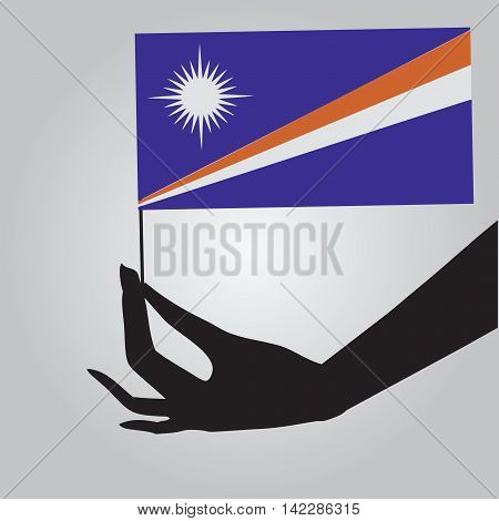 Flag of Marshall Islands in a female hand. Vector illustration.