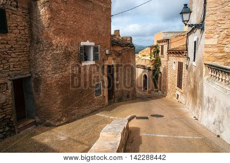 Paving stone streets in historical town part of Capdepera with its traditional stone houses Mallorca Spain